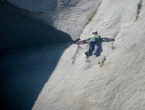 Chris McNamara on the last move on the Great Roof on The Nose of El Ca...