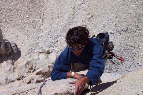 Joey Papazian climbing the 5.6 exposed arête on Pitch 7 of the Red Dih...