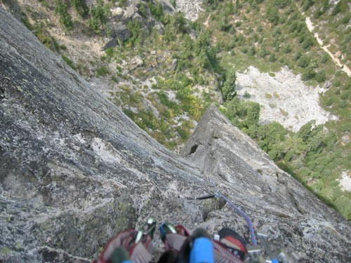 Looking down at the third pitch.