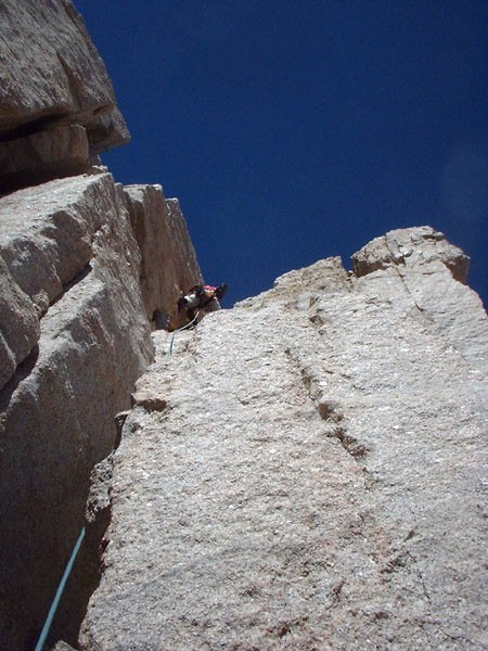 Tom Mason climbing pitch 8 of East Buttress, Mt. Whitney.
