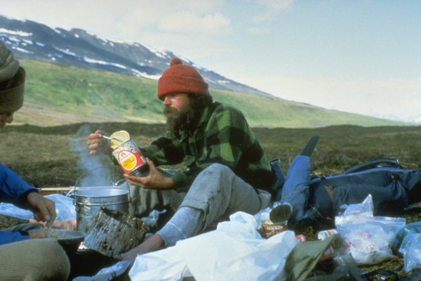 Chowing down on canned goods salvaged from a bear-destroyed miners sha...