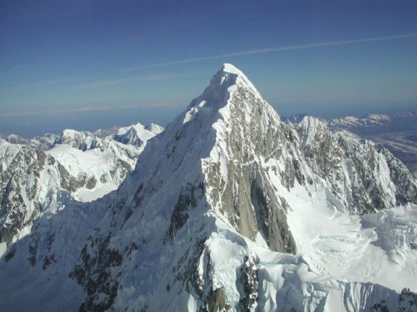 Colton/Leech follows the shaded gully. The top of the French Icefall i...