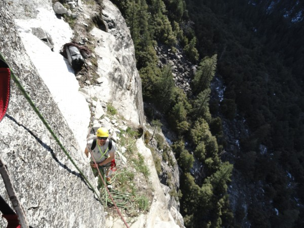 Dan belaying from a snowy ledge during the 2nd pitch. Don't go too far...