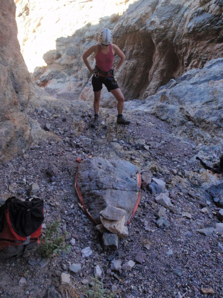 Johanne checks the stream-bed block anchor in Bad Canyon