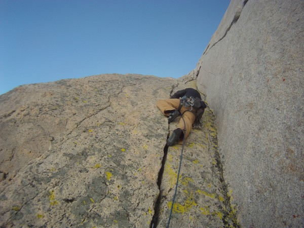 Charlie on the  classic triple crack corner, North buttress of Merriam...