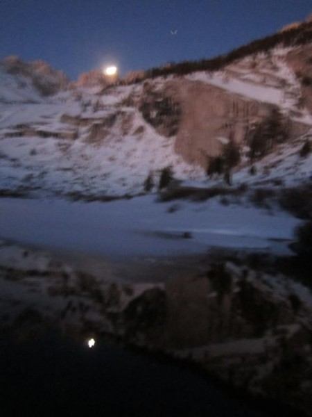 February almost-full Moon sets over the Sierra on my predawn approach ...