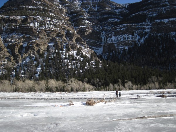 Matt and Nathan crossing the well frozen South Fork of the Shoshone Ri...