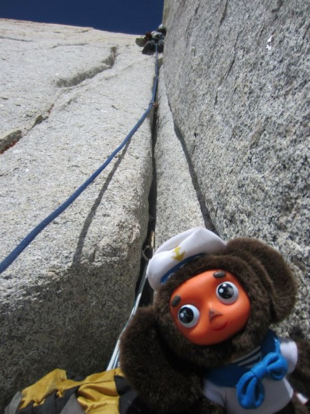 Cheburashka loafs around the belay, doing nothing, as Vitaliy and I do...