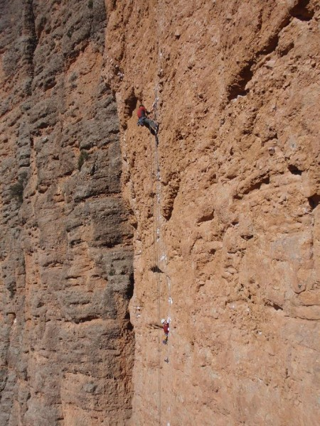 Approaching the first crux, a small overlap. Some Spanish climbers on ...