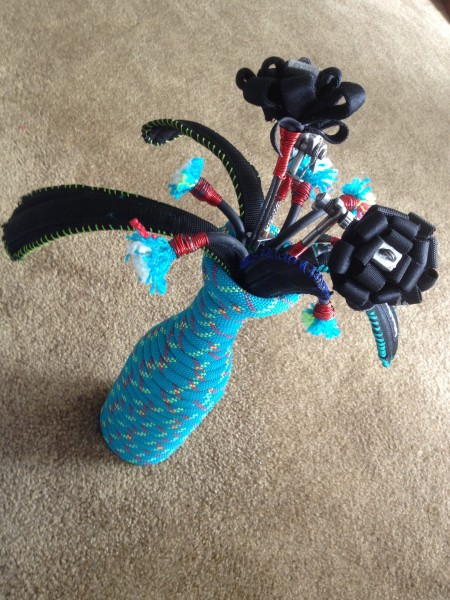 Vase made of rope. Flower made of retired cams, nuts, webbing and a ha...