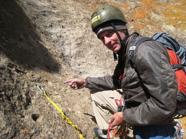 One-bolt belay at start of traverse pitch after the 2 single rope raps