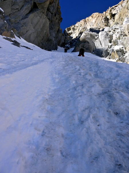 Pat Baumann and Kevin Trieu soloing the steep snow in the right couloi...
