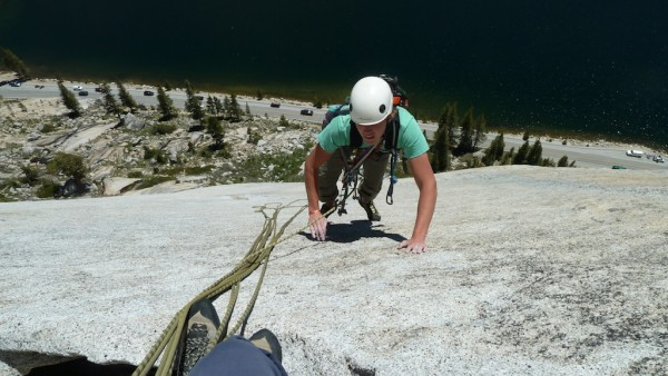 Padding up that holdless slab on the third pitch.