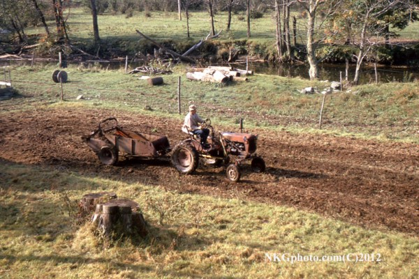 Pa Spreading sh#t about 1971? Farmall tractor. Don't know the model.