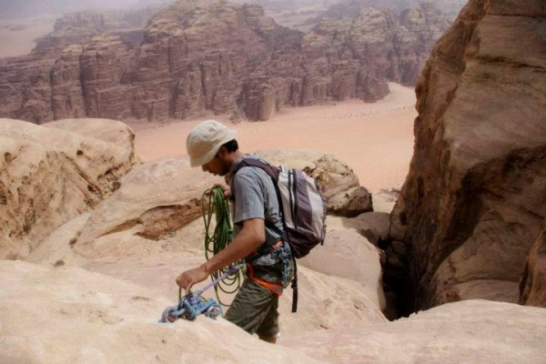 My Bedouin rock-climbing guide setting up a rappel