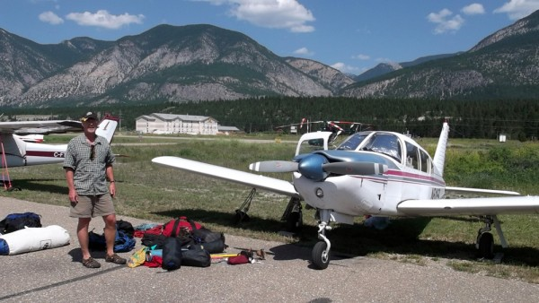 Sierra tied down on the ramp at Invermere, sorting our gear and packin...