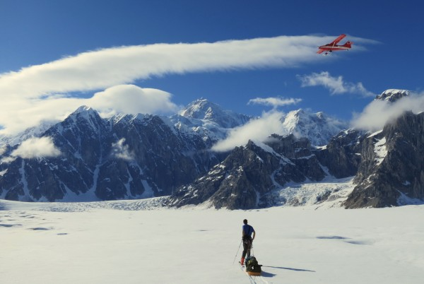 A plane of tourists flying through, with Denali in the background - wo...