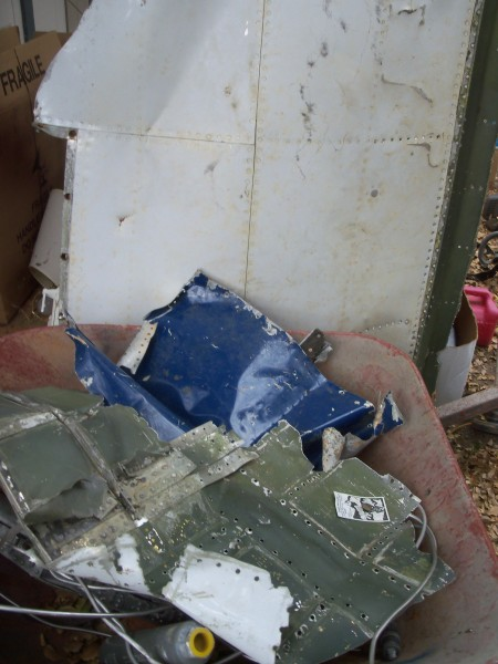 Part of the wing (I think) and a wheelbarrow full of pieces.