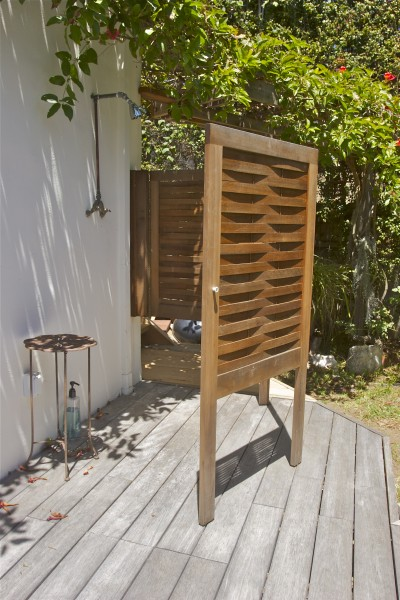 Folding redwood shower enclosure made of old growth heart bender board...