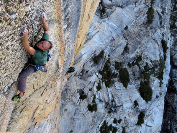 Jim Thornburg entering the crux of P4, with Matt Schutz belaying on Ta...
