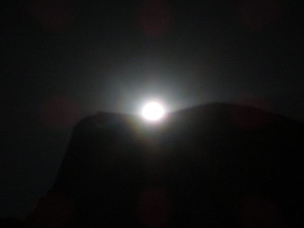 moon behind half dome