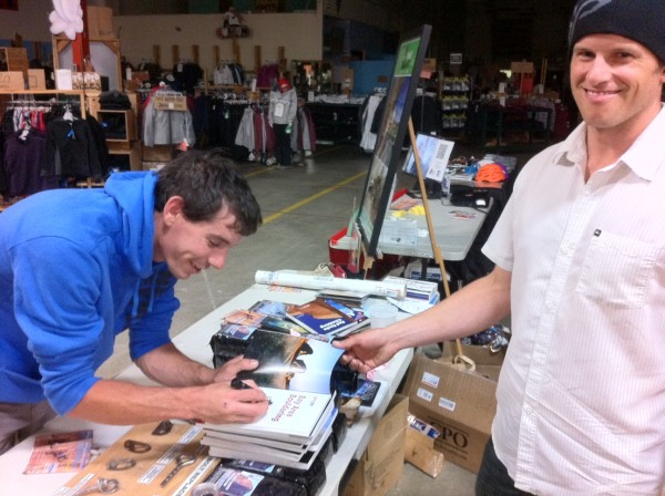 Chris Mac and Alex Honnold signing books for the October 9 ASCA Fundra...