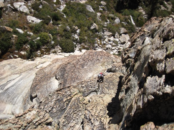 Rob cruising up chickenheads on the second pitch of the SE Buttress of...