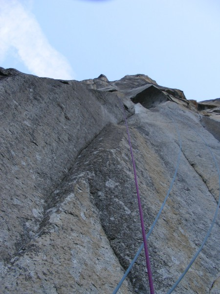 Looking up from the end of pitch 1. The blue rope leading to the pitch...