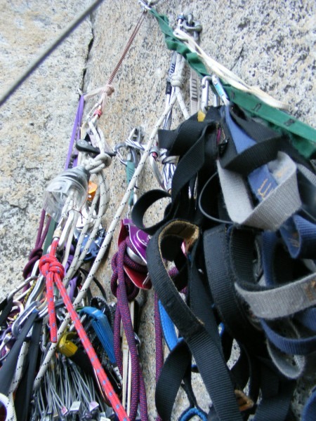 Part of the standard belay station cluster at pitch 6.