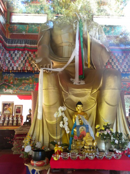 Inside the Temple is a beautiful golden Buddha about 40 feet tall.  Un...