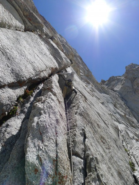 Mike starting the 10c crux pitch of the Harding Route on Conness