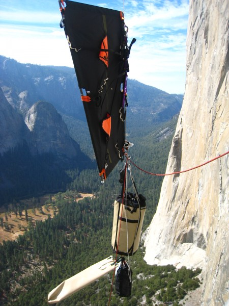 Flagged portaledge over Henri. Note the portaledge bag being blown hor...