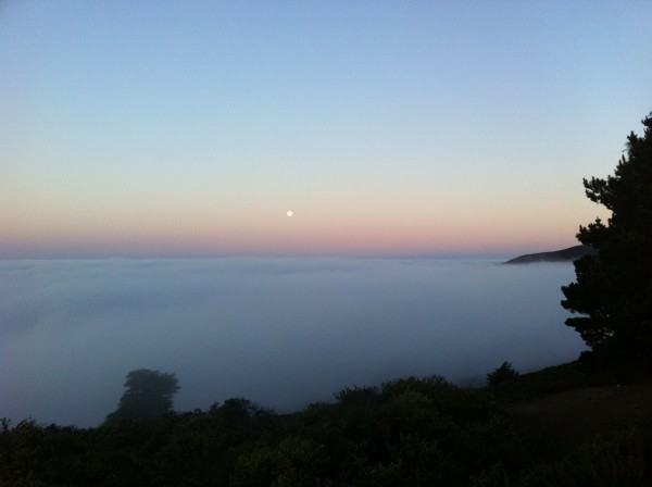 Leaving moonset at sunrise over fog carpet of Bolinas heading for Yose...