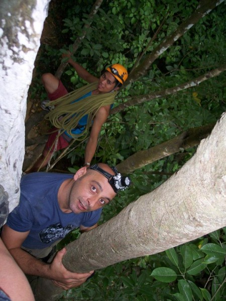 Raymund retrieving the rope we used to belay the girls into the cave. ...