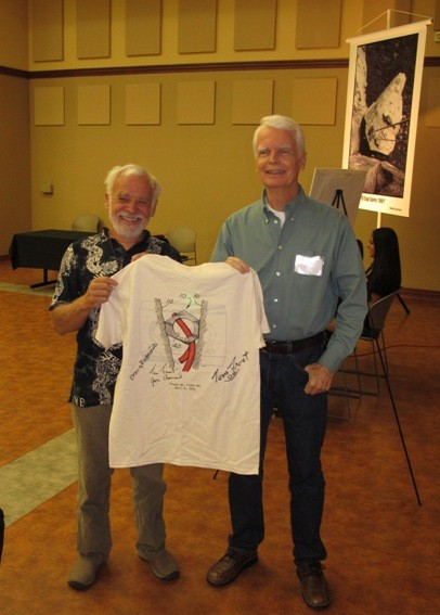"Doug Robinson and Tom Frost, holding Guido's  company's ""PatentWear"" T..."