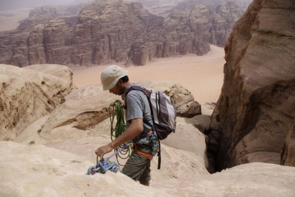 Bolted rap anchor. Descending from the summit of Jebel Khazali.