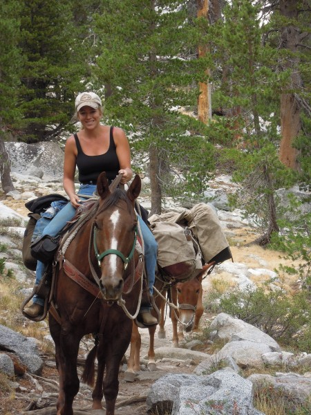 Brooke wrangling mules into Angel Wings base camp before the ascent of...