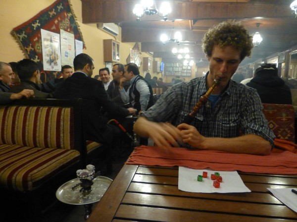 Smoking nargile and playing dice in a tea shop