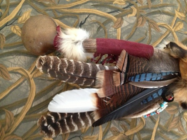 Feather fan & rattle detail