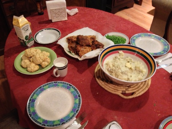 Fried chicken, mashed potatoes, peas, biscuits.