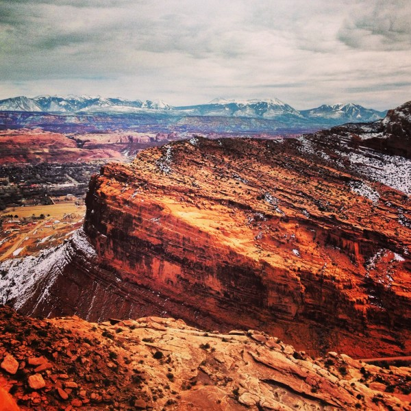 La Sal Mountains with the Moab Rim trail in the foreground.