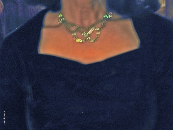 A photograph of me in blue with a rhinestone necklace taken about 2005...