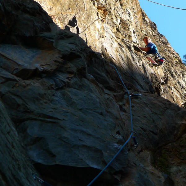 Bill Price on the first assend of his new route, Remember 911. 5.10d, ...