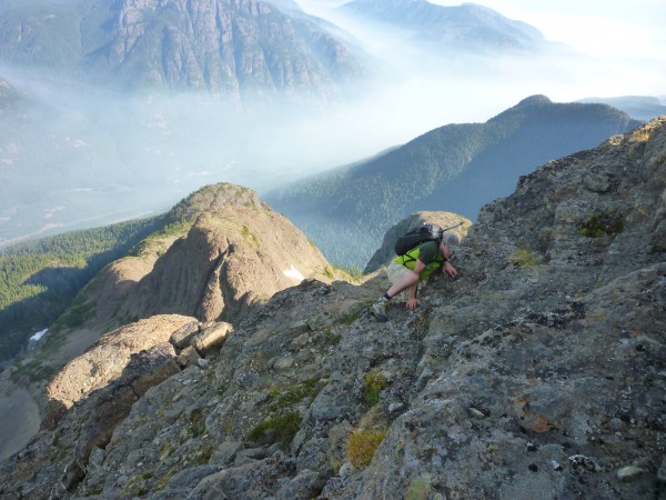 Carman topping out onto the summit block with purple haze flowing thro...
