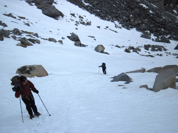 Vito and Sean hiking up canyon on pretty well filled-in and fairly pac...