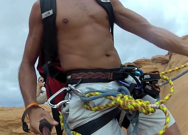 Guy jumping onto Grigri with end of rope clipped into gear loop. Cross...