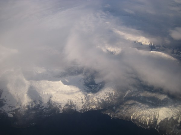 Partial clearing revealing some Alaskan coastline - it had been cloudy...