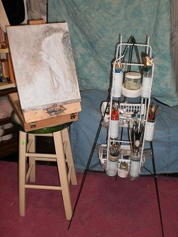 made me an easel :)  out of plant hanger, package tape, and plasti...