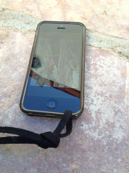 Connecting the lanyard to the iPhone case. I used a shoelace but you c...