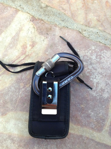 Connecting the iPhone holster case to a locking carabiner. It's import...